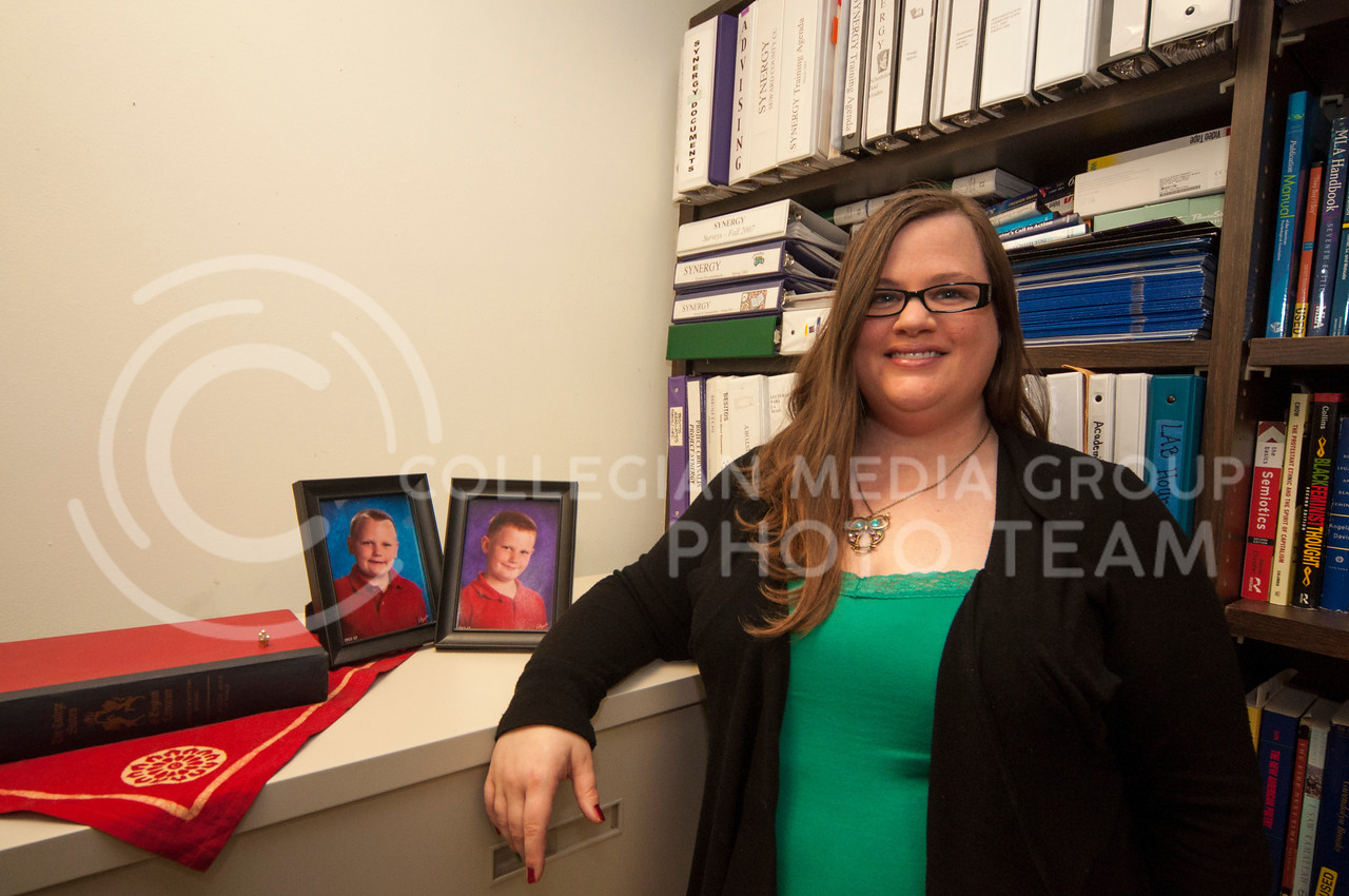 Melissa Prescott poses in her office in Bluemont Hall with pictures of her two sons.