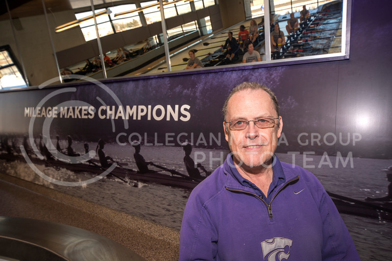 Coach Patrick Sweeney poses in the tank room of the new rowing facility on Feb. 13.