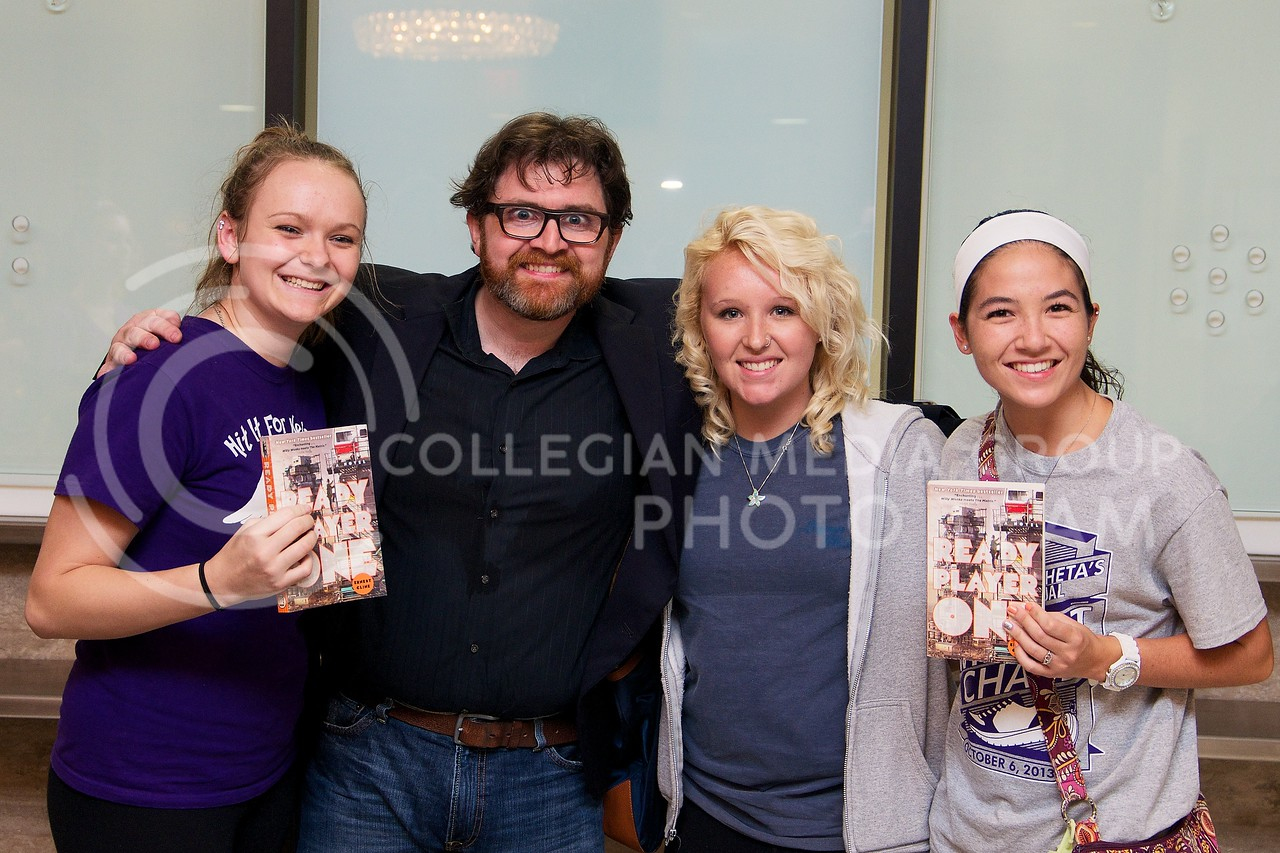 K-State students Falon Runnebaum (left), freshman in accounting, Daphne Park, freshman in family studies (2nd from right), and Anna Sevart, freshman in life sciences, have their picture taken with Ernest Cline after he spoke at McCain Auditorium on Thursday night.  Ernest Cline's novel, Ready Player One, was chosen as this years common book for K-State incoming freshman.