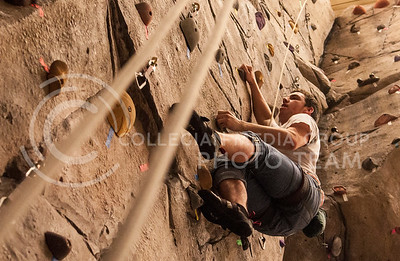Nick Harvey, junior in advertising, manuvers up the wall at the Rec Center on Feb. 19.
