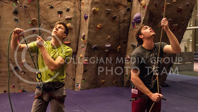 Tyler Vollick, second year senior in geography and natural resource enviromental science, and Brendan Heffernan, junior in physics, belays climbers on the wall at the Rec Center on Feb. 19.