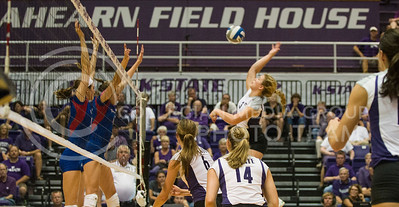 Junior outside hitter Chelsea Keating hits one over the net against KU at Ahearn Fieldhouse on Oct. 2. The Jayhawks swept the Wildcats in three sets.