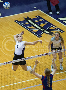 Junior outside hitter Chelsea Keating goes up for a spike against KU at Ahearn Fieldhouse on Oct. 2. The Wildcats fell 6-1 during both contests in the 2013 season.