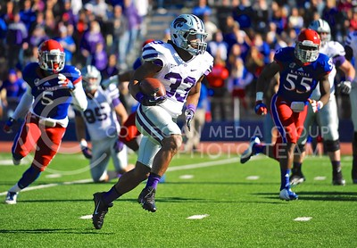 Senior running back John Hubert blazes by some KU defenders during the second quarter of the annual Sunflower Showdown Saturday in Memorial Stadium in Lawrence. Hubert rushed for a career-high 220 yards and one touchdown, moving up to #2 all-time in rushing at K-State, trailing only Darren Sproles.The Wildcats beat the Kansas Jayhawks 31-10, bringing their current win streak in the series against their intrastate rivals to five.