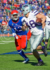 Redshirt freshman Glenn Gronkowski outruns KU cornerback Dexter McDonald to score K-State's third touchdown after catching a pass from junior quarterback Jake Waters during the second quarter of the annual Sunflower Showdown Saturday in Memorial Stadium in Lawrence. The Wildcats beat the Kansas Jayhawks 31-10, bringing their current win streak in the series against their intrastate rivals to five.