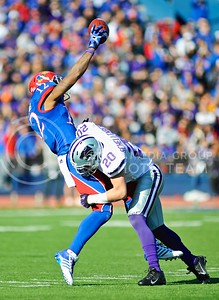 Junior defensive back Dylan Shellenberg tackles KU wide receiver Christian Matthews as Matthews makes a one-handed catch during the third quarter of the annual Sunflower Showdown Saturday in Memorial Stadium in Lawrence. Shellenberg intercepted a pass from KU quarterback Jake Heaps during the first quarter of the game. The Wildcats beat the Kansas Jayhawks 31-10, bringing their current win streak in the series against their intrastate rivals to five.