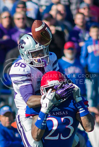 Senior wide receiver Trammaine Thompson covers the face of KU senior safety Dexter Linton during the 31-10 at Lawrence on Nov. 30.