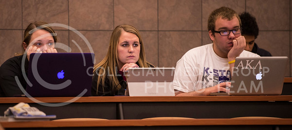 (from left) Crystal Dau. freshman in agricultural economics, Jordan Wheeler, junior in agricultural business and Logan Hays, sophmore in communication studies, listen to Dr. Steve Smethers in Mass Comm. in Society and use various platforms to take notes in Umberger 105 on Feb. 19.