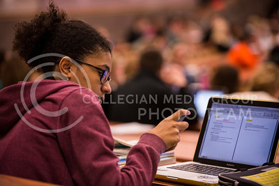 Anaïs Franchitti, freshman in journalism, takes a break from taking notes to check her phone in Mass Comm. in Society in Umber 105 on Feb. 19.