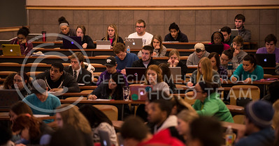 Students use both laptops and traditional paper and pen to take notes in Mass Communications in Society in Umberger 105 on Feb. 19.
