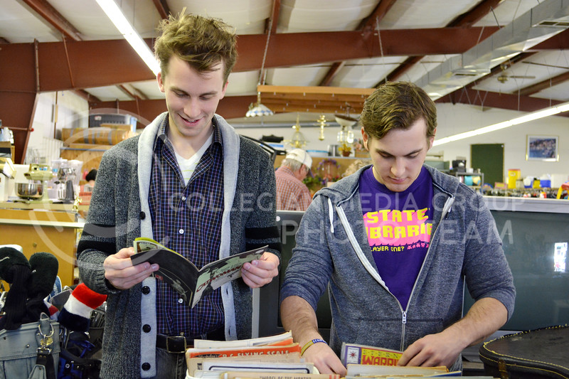 Ben Windholz, senior in communication studies, looks through a Catwoman comic book while his friend, Felix Theriault-Briand, also a senior in communication studies, browses through another box of comics. Windholz and Theriault-Briand visited the Grand Ol' Trunk Thrift Shop in Manhattan, KS on February 15.
