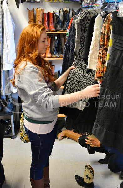 Jessica Parr, junior in metalsmithing, browses through some sweaters at Rockstar and Rogers Clothing and Costume in Aggieville on February 15.