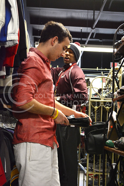 Daniel Weisman, freshman in business/finance, looks at some shoes with his friend Stephen Morrell, junior in psychology, at Rockstar and Rogers Clothing and Costume in Aggieville on February 15.