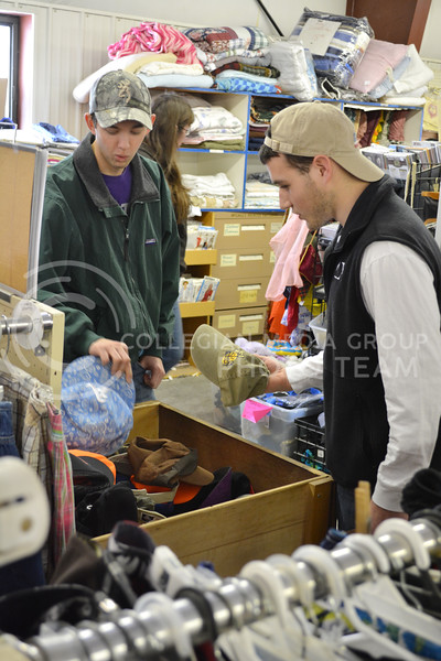 Kyle Mayer, Sophomore in Constuction Science, and Davis Millard, Freshman in Criminology browse through some hats at the Grand Ol' Trunk Thrift Shop in Manhattan, KS on February 15th.