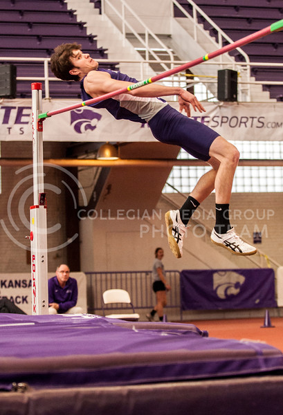Miles Bearden, freshman in agribusiness, attempts the high jump at the K-State Invitational in Ahearn Field House on Jan. 25.
