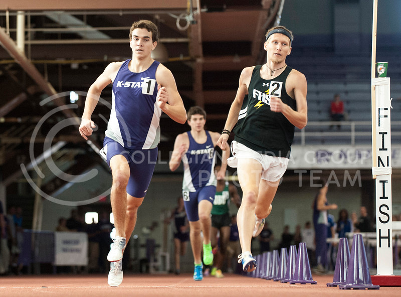 Freshman distance runner Kain Ellis rounds a curve in his one mile race that he finished second in at the K-State Invitational on Jan. 25, in Ahearn Fieldhouse. Ellis finished with a time of 4:21.66.