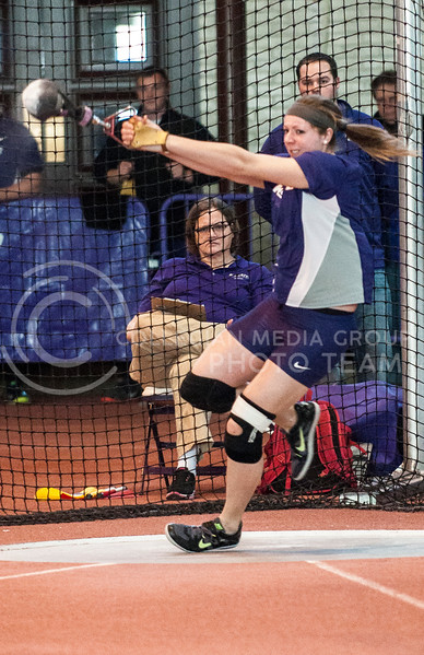 Haley Pitko, red shirt freshman in nutrition and kinesiology, participates in the weight throw at the K-State Invitational in Ahearn Field House on Jan. 25.