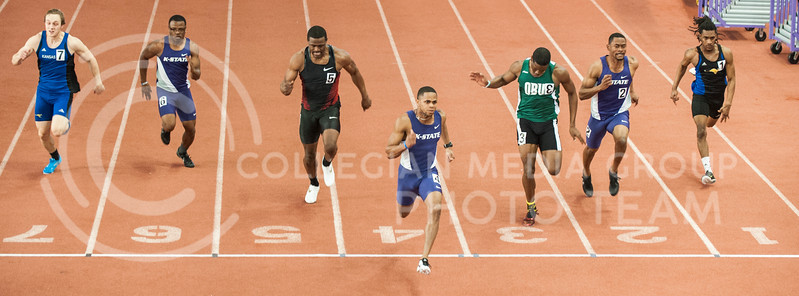 Senior sprinter Carlos Rodriguez strides over the finish line at the K-State Invitational on Jan. 25, in Ahearn Fieldhouse. Rodriguez finished wiht a time of 6.74 seconds and ranks 4th in the Big 12.