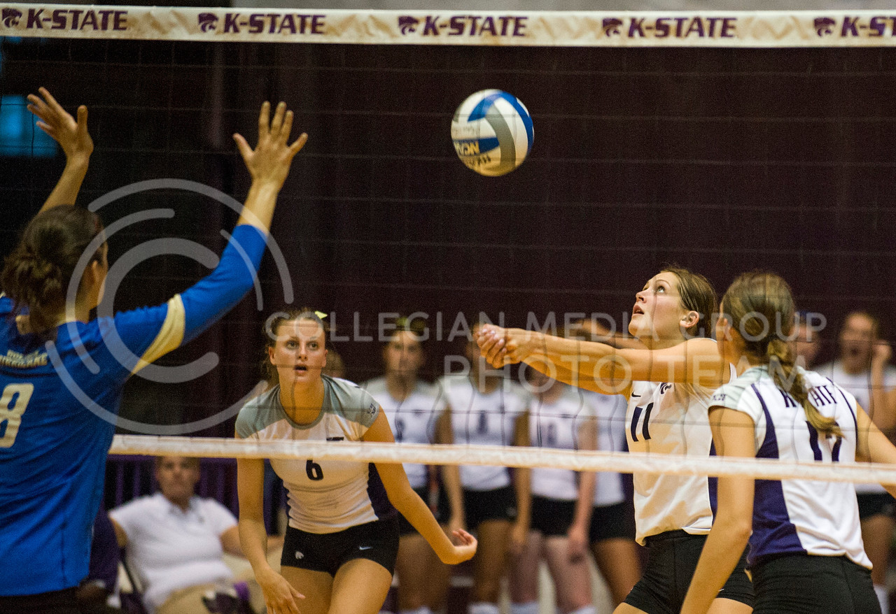 Senior middle blocked Kaitlynn Pelger sets the ball during the Sept. 10 game against Tulsa in Ahearn field house.