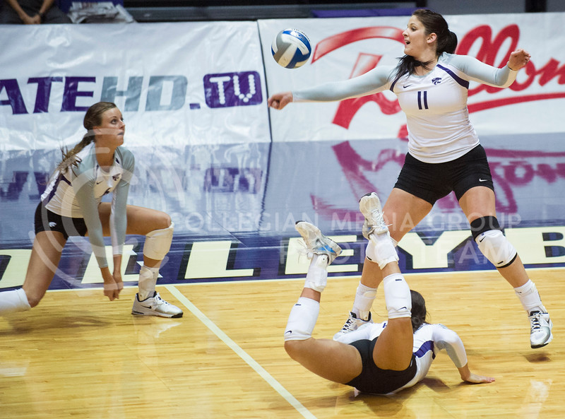 Senior outside hitter, Lilla Porubek, bumps the ball as her teammates dive in at the Sept. 24 game against the Italian U-23 National Team in Ahearn field house.