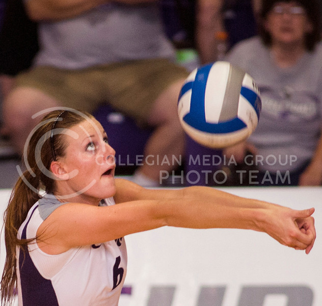Red shirt freshman setter Katie Brand bumps the ball to a teammate Saturday on Sept. 7, 2013 at Ahearn Fieldhouse. Brand was named MVP of the Wildcat Invitational as the Wildcats swept all three teams in three sets each.