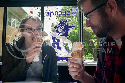 "Brohgan Dieker, of international admissions, and her husband Adam Dieker, senior in social sciences, enjoy Call Hall ice cream in the dairy bar on Sept. 20, 2013.  Brohgan Dieker ordered Wildcat 105, because ""it's good,"" and even though she's had it before she's ""always liked it."""