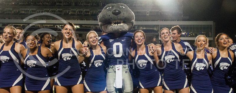 Photo by Hannah Hunsinger | Royal Purple<br /> Willie sways with the cheerleaders during the alma mater.