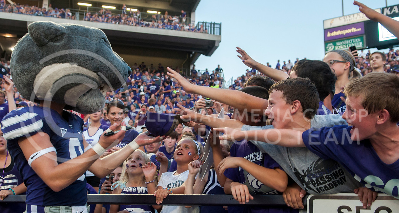 Young fan vie for Willie's attention to get autographs and photos during the  KSU vs UL game on Saturday, Sept. 9, 2013, in Bill Snyder Family Stadium. Photo by Hannah Hunsinger   Royal Purple
