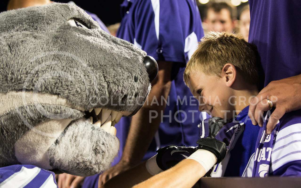 A young fan gets his shirt signed by Willie at the KSU vs UMass game on Saturday, Sept. 14, 2013, in Bill Snyder Family Stadium. Photo by Hannah Hunsinger   Royal Purple