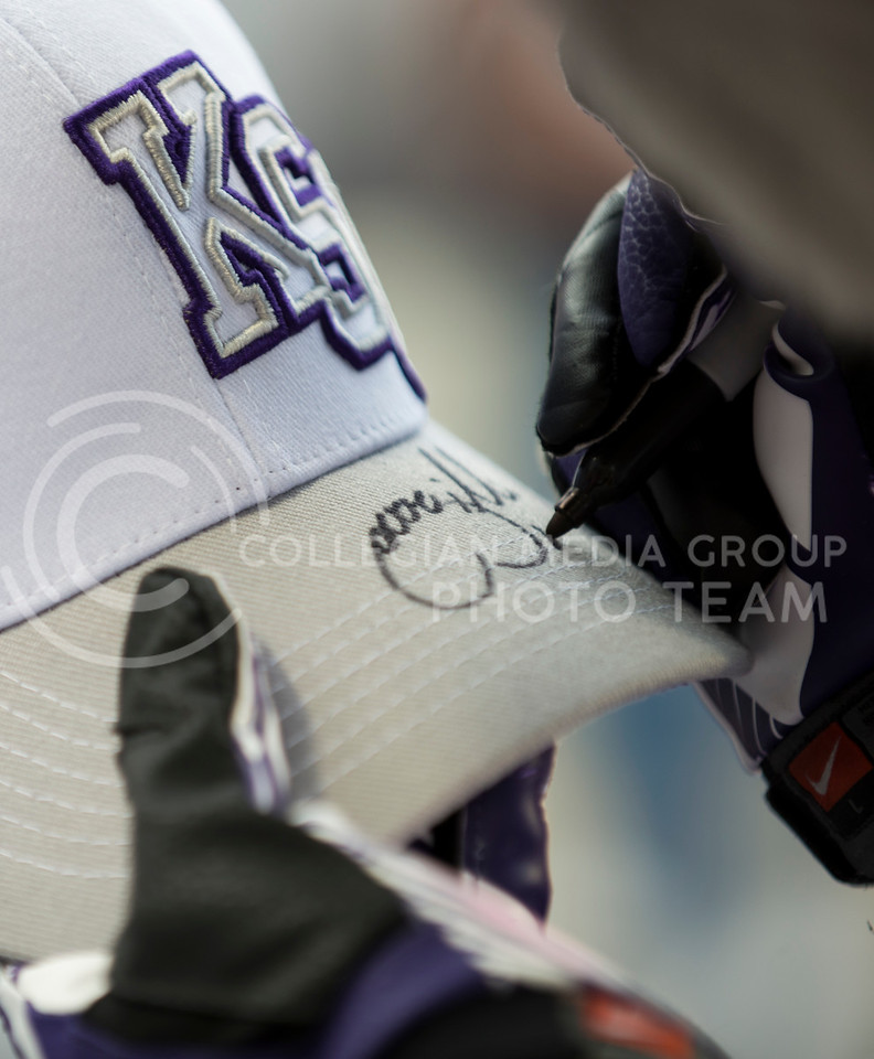 Willie signs an autograph during the KSU vs UMass game on Saturday, September 14, 2013 in Bill Snyder Family Stadium Photo by Hannah Hunsinger | Royal Purple