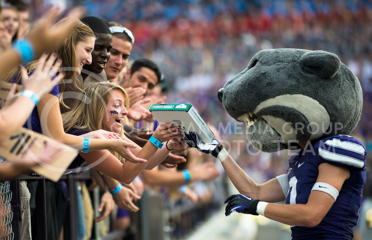 Kim Bogner, junior in mechanical engineering receives a pizza from Willie during the KSU vs UMass game on Saturday, September 14, 2013 in Bill Snyder Family Stadium. Photo by Hannah Hunsinger   Royal Purple