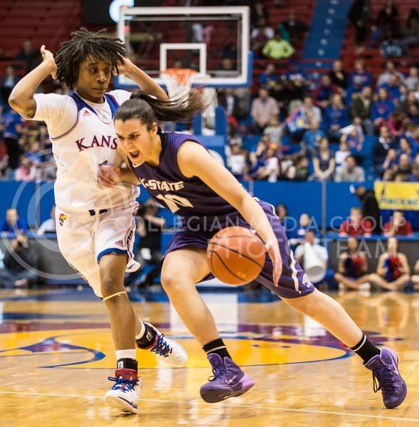 Freshman guard Leticia Romero charges past Kansas sophomore guard Lamaria Cole on her way to the basket Wednesday night at Allen Fieldhouse in Lawrence, where the Wildcats beat the Jayhawks 76-68.