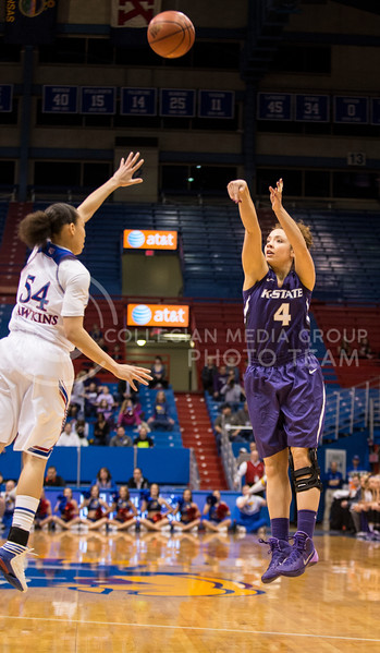 Katya Leick, senior forward, shoots from three during the KU game at Allen Fieldhouse on Feb. 26.