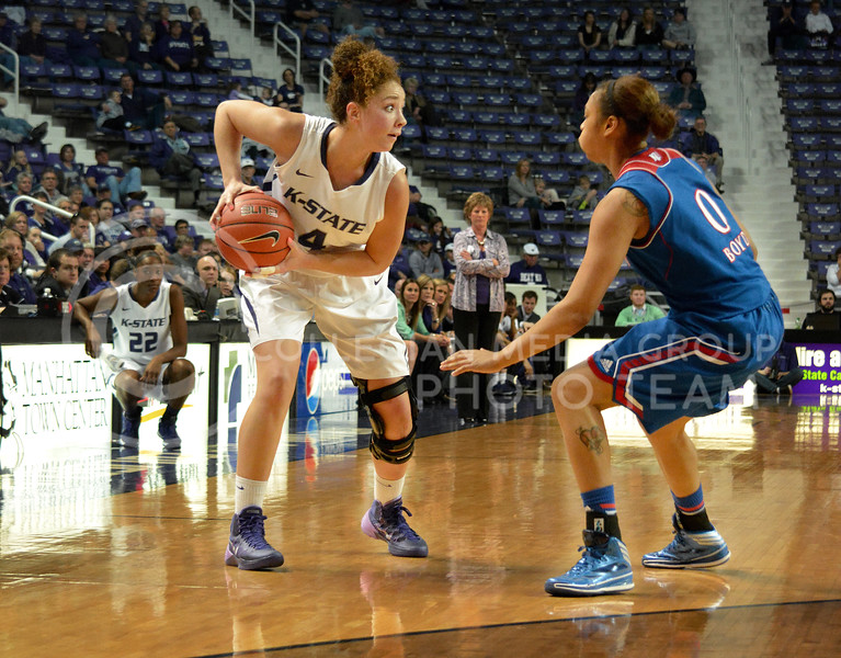 Senior forward Katya Leick looks to pass around KU guard Aisa Boyd.