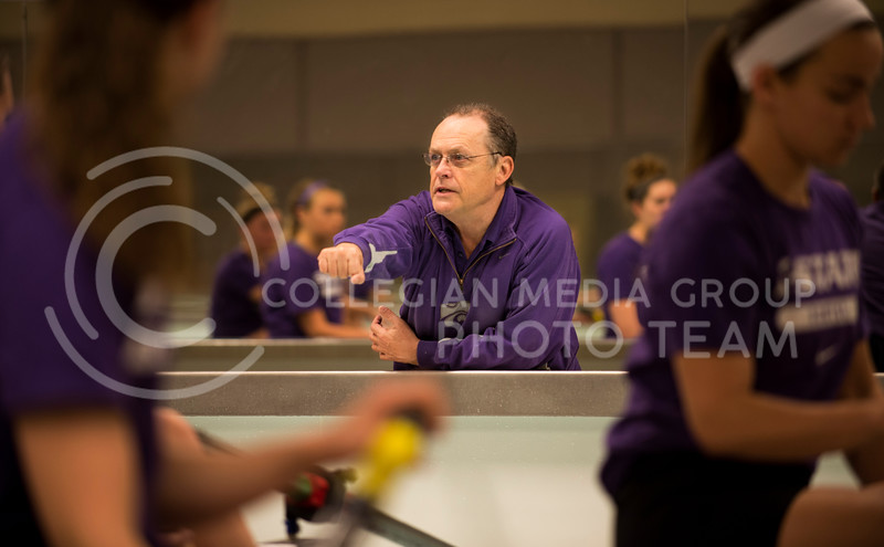 Coach Patrick Sweeney gives the women's varsity rowing team instructions during rowing practice on Feb. 13, the tank room of the recently constucted rowing center.