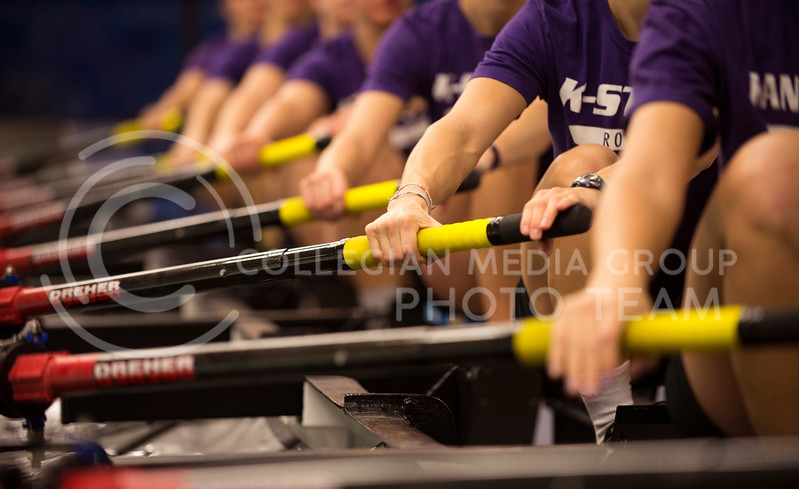 The women of the varsity rowing try to keep their strokes in perfect unison during practice in the tank room on Feb. 13, 2013.