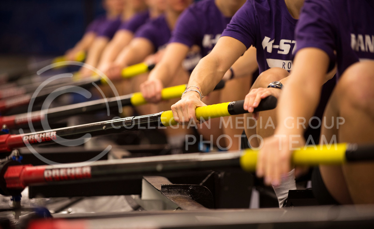 The women of the varsity rowing try to keep their strokes in perfect unison during practice in the tank room on Feb. 13.