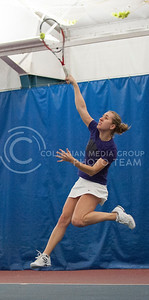 Senior tennis player Petra Niedermayerova returns a hit against Wichita State on March 8, 2014 at the Body First Tennis and Fitness Center.