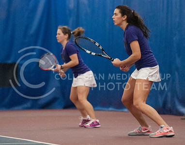 Freshmen Iva Bago and  Palma Juhasz prepare for the serve during a doubles match against Wichita State on March 8 at Body First Tennis and Fitness Center.