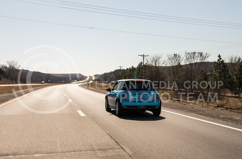 Sophomore in mass communications, Jack Bresser drives his car on Bill Snyder Highway on Feb. 26, 2017. (John Benfer | Royal Purple)