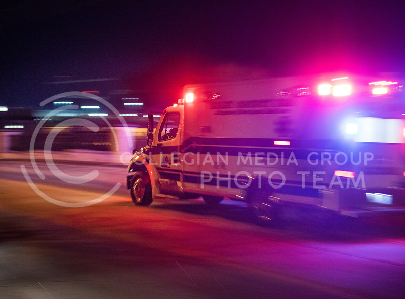 An ambulance rushes down Denison Road with its sirens on in Manhattan, Kansas on Feb. 26, 2017. (John Benfer | Royal Purple)