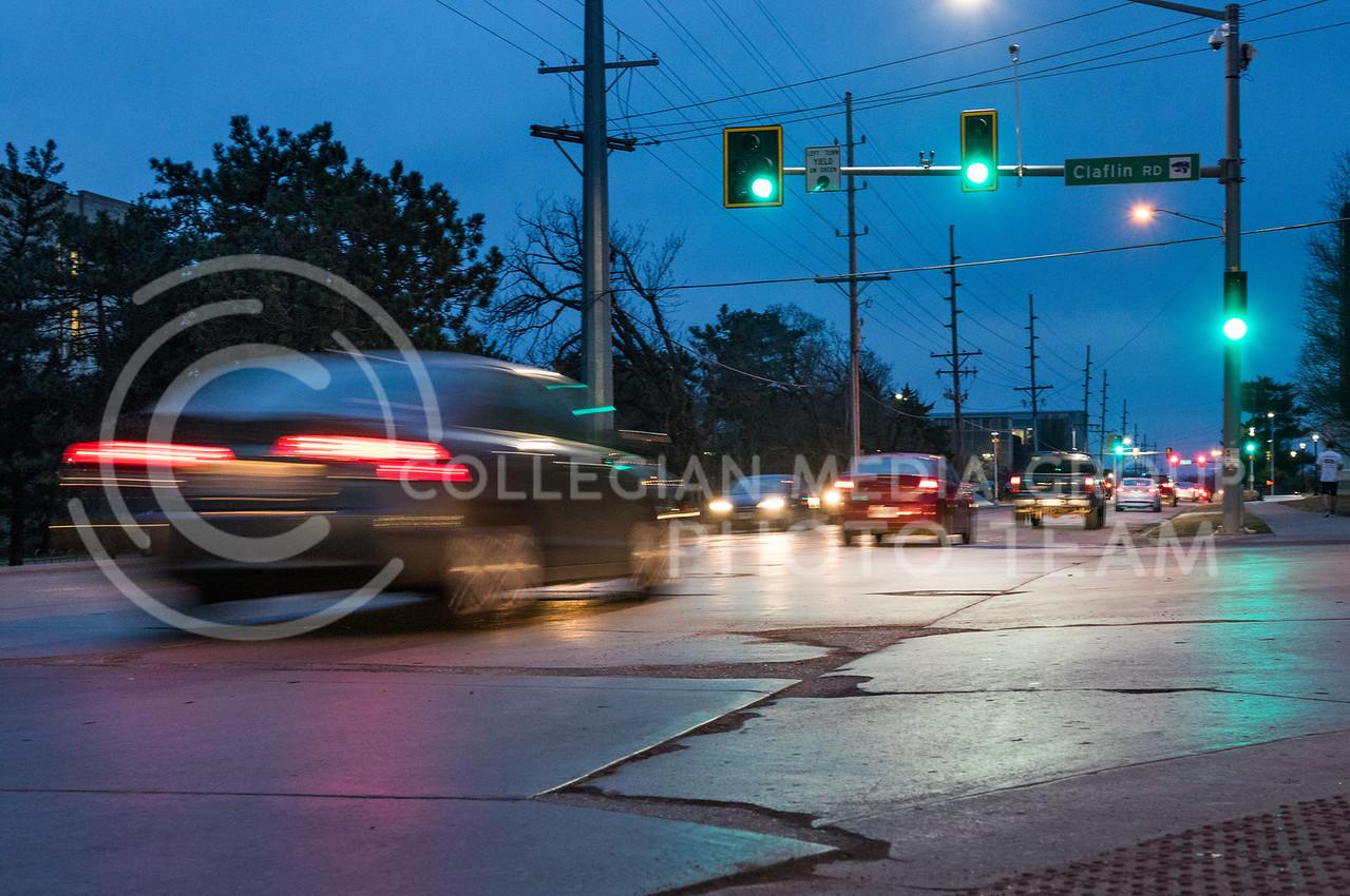 Vehicles drive through the Claflin and Denison intersection in Manhattan, Kansas on Feb. 26, 2017. (John Benfer   Royal Purple)
