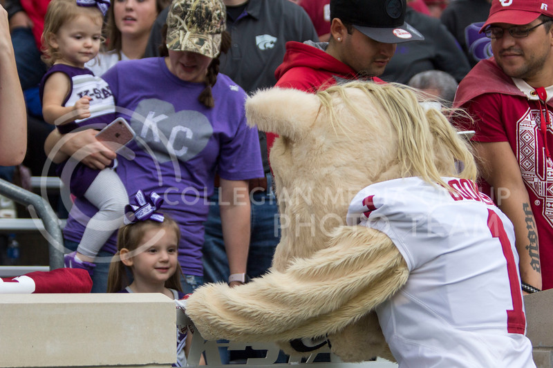A mom and her children say hi to Boomer the Oklahoma mascot during the K-State game vs. Oklahoma at Bill Snyder Family Stadium in Manhattan, KS on October 21, 2017. (Sabrina Cline | Collegian Media Group)