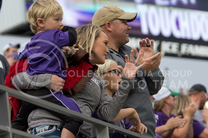 A family cheers on the Wildcats during the K-State game vs. Oklahoma inside Bill Snyder Family Stadium in Manhattan, KS on October 21, 2017. (Sabrina Cline | Collegian Media Group)