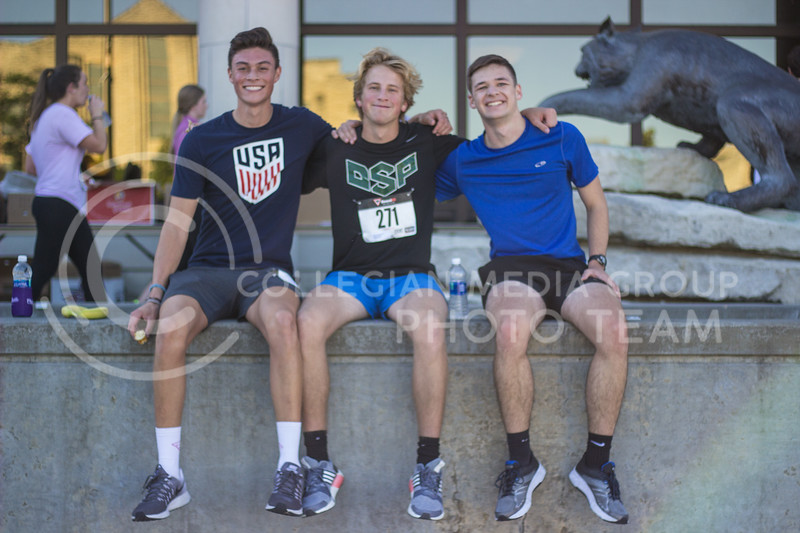 Members of Delta Sigma Phi Zach Bird, Kinesiology student, Nate Faflick, studying Human Development and Family Studies, and Charlie Kaifes, an Electrical Engineering student at the Homecoming 5k at the Alumni Center on October 15th, 2017. (Kelly Pham | Collegian Media Group)