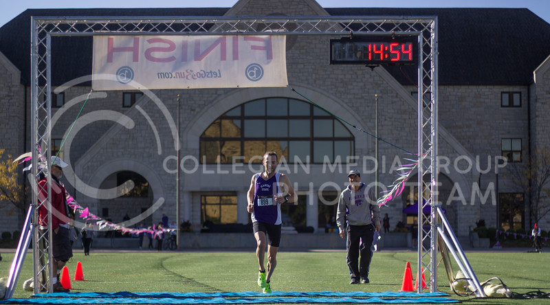 Joe Moore, first runner through at the Kansas State Homecoming 5k at the Alumni Center on October 15th, 2017. (Kelly Pham | Collegian Media Group)