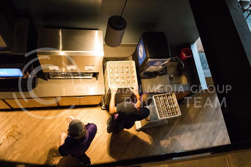 A Kramer worker refills cups in the Kramer Dining Center on Feb. 1, 2017. (John Benfer | Royal Purple)