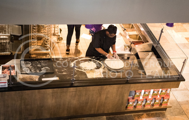 A Kramer chef rolls pizza dough in the Kramer Dining Center on Feb. 1, 2017. (John Benfer | Royal Purple)