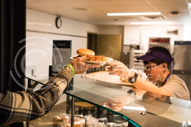 A Kramer worker serves food to a student in the Kramer Dining Center on Feb. 1, 2017. (John Benfer | Royal Purple)