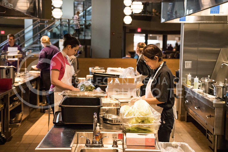 Kramer workers prepare food in the Kramer Dining Center on Feb. 1, 2017. (John Benfer | Royal Purple)